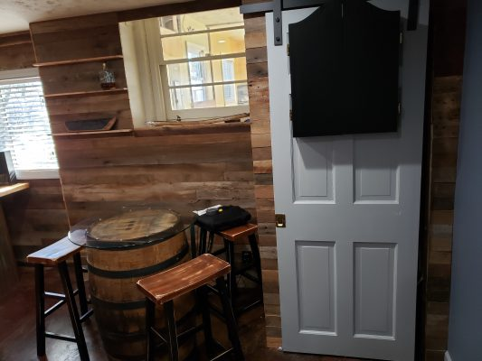 Man Cave, Finished Back Wall with Sliding Barn Door